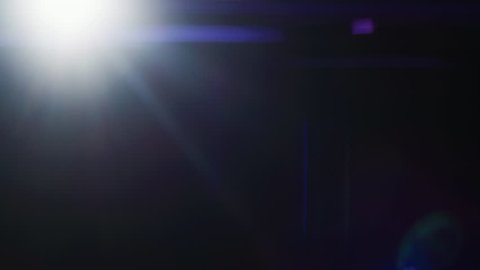 FX Special Effect. Easy to Use in Blend / Overlay Modes.Corner Light Growing and Subsiding on the Black Background. Real Lens Flare with Anamorphic Effect.  Shot on RED EPIC-W 8K.