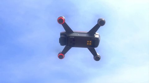 RC quadcopter hovers in the air, slow motion.