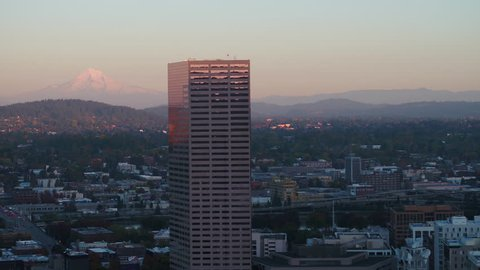Aerial Oregon Portland NW Downtown November 2017 Dusk 90mm Zoom 4K Prores  Aerial video of Big Pink U.S. Bancorp Tower in Portland with Mt Hood in background.