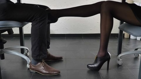 Shooting Under The Table Y Female Leg In Shoes With High Heels Gently Touches