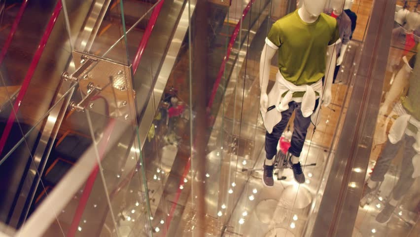 View through window to modern concept manikins at the store. Government manipulation concept.