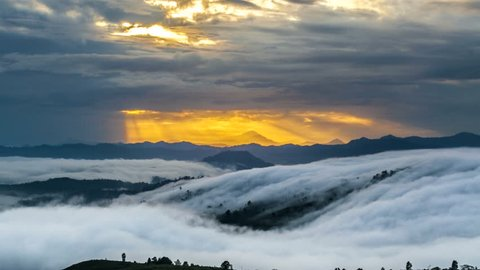 Sunrise,sea of cloud,moving misty and ray of sunlight. Taken at Ranau,Paragliding Park,Sabah,Borneo,Malaysia. Time lapse