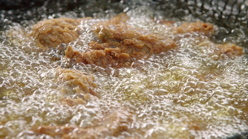 View footage of frying Chicken in boiling hot oil