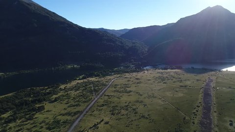 Aerial drone Scene of mountains, trees and estepa, Cerro Los Angeles, Huechulafquen lake, Neuquen, Patagonia, Argentina, National Park Lanin, sunny day in summer. Dirt road anc tracking cars, Camera m