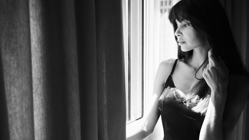 Sensual woman in lingerie looking out of window | Shutterstock HD Video #1010739494