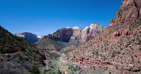 timelapse of shadows and clouds moving across the landscape of zion national park also showing the traffic levels during spring break