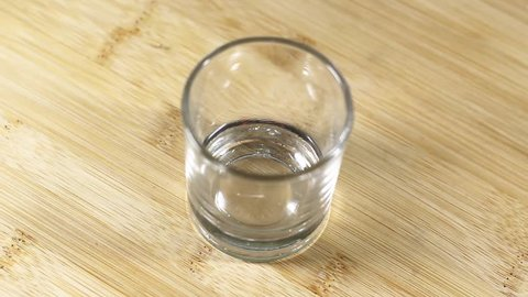 Empty glass over wood background