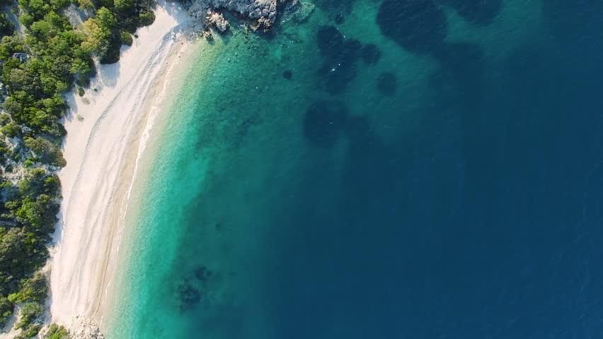 CRES, CROATIA: Aerial view of popular tourist destination Lubenice beach. 4k drone video forward.
