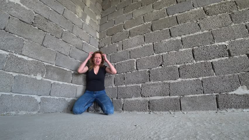 desperate unhappy woman by the wall. 4k, the concept of stress and hopeless #1010779004