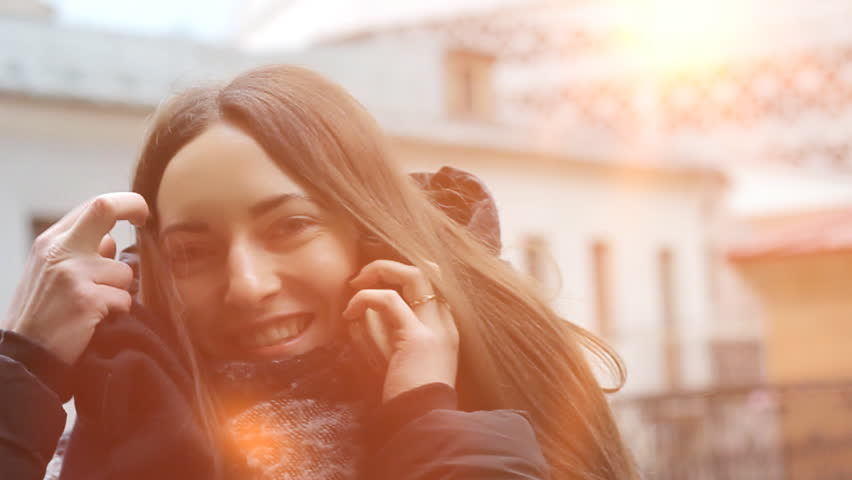 Young girl with smartphone are call and speaking with friend. She is smiling. Sunset and warm autumn background. | Shutterstock HD Video #1010791934