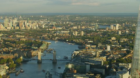 London UK - November 2017: Aerial sunset view London city skyline Shard modern glass skyscraper River Thames Tower Bridge Canary Wharf England UK RED WEAPON