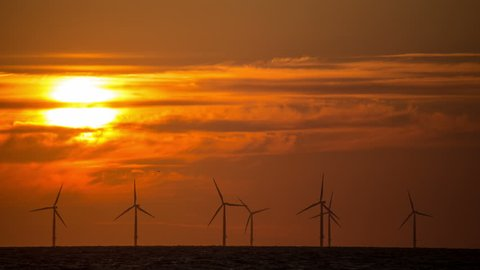 4k sunset over Colwyn Bay wind farm on the North Wales coast