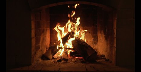 Burning Fire In The Fireplace. Slow motion. A looping clip of a fireplace with medium size flames