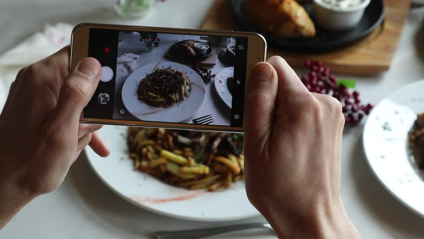 Hands taking photo various dishes with smartphone #1010887004