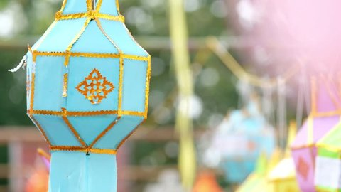 Lanna lantern hang on the rope to wish a desire or hope for good thing to happen, in northern thai style lanterns at Loi Krathong (Yi Peng) Festival, Chiang Mai, Thailand