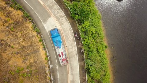 Aerial view of swamps and road in the Philippines, truck passing by  4K resolution video