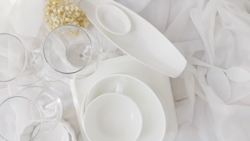 White porcelain dishes and transparent wine glasses. Slow rotation, top view, | Shutterstock HD Video #1010944514