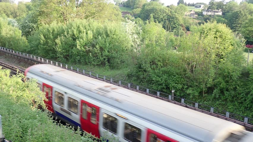 London Underground train passing by in Hertfordshire countryside