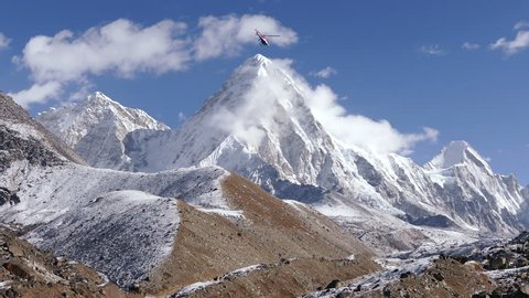 Helicopter flight over the Solu Khumbu valley towards the base camp of the Everest peak.