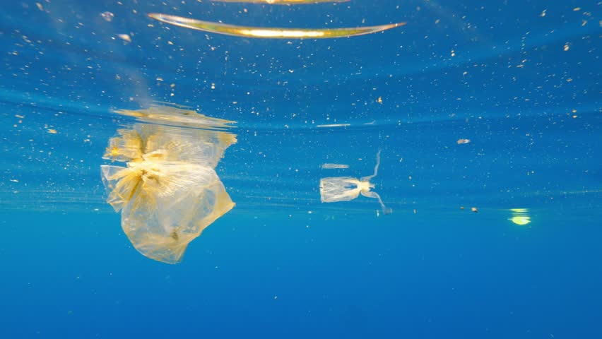 Garbage and plastic rubbish in blue ocean water, environmental problem concept. Indonesia, Bali