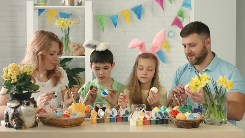Family preparation for easter indoors | Shutterstock HD Video #1010983994