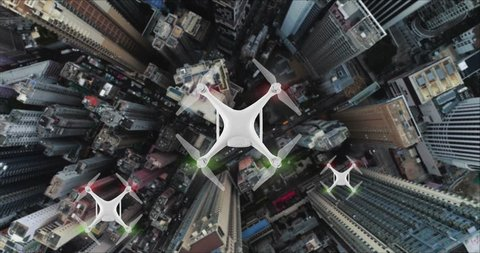 AERIAL. Top view of Group of Drones delivers the goods against the background of Hong Kong city.