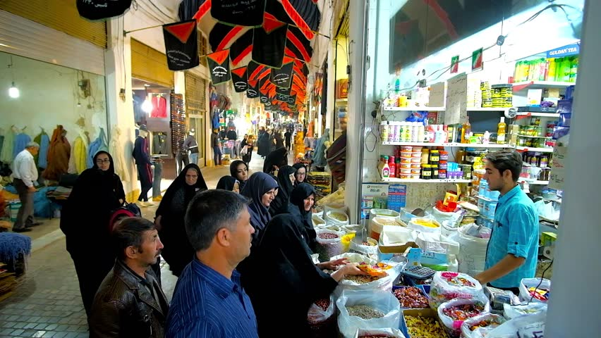 KASHAN, IRAN - OCTOBER 22, 2017: The crowd of locals at the food stall of Grand Bazaar, people buy cereals, nuts, seeds and other products, on October 22 in Kashan.
