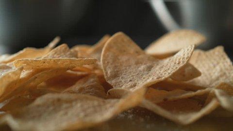 Adding salt on tortilla chips. Shot with high speed camera, phantom flex 4K. Slow Motion.