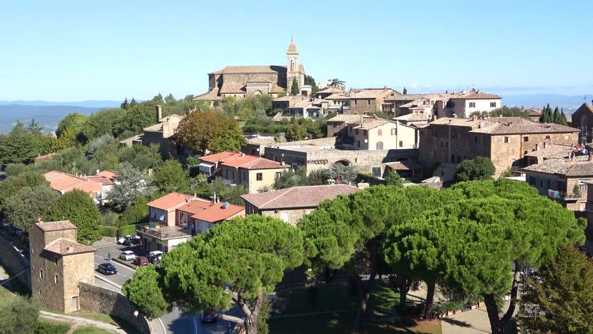 Cathedral of San Salvador in the city landscape. Montalcino, Italy