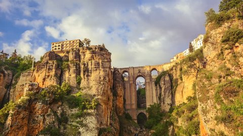 Ronda, Spain- Panning time lapse of Puente Nuevo during sunset golden hour, the iconic bridge in an ancient mountaintop city in souther Spain