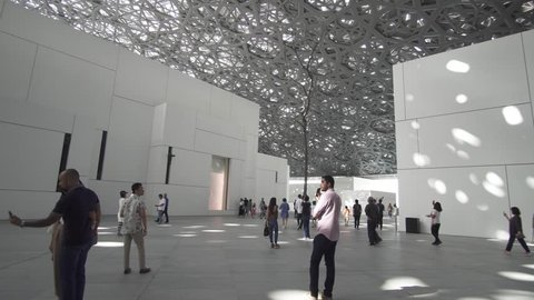 Abu Dhabi, UAE - April 04, 2018: Interior of the new Louvre Museum in Abu Dhabi showing reflections of the Rain of Light dome stock footage video