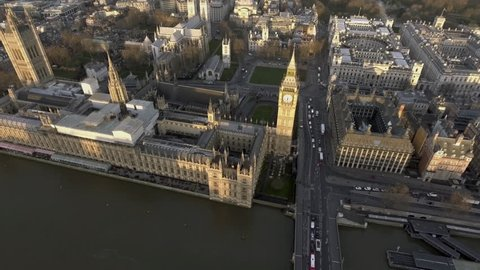4K London Bird View of Houses of Parliament, Big Ben, Palace of Westminster and Gothic Historical Landmarks Buildings from Up High at Sunset in England, United Kingdom UK