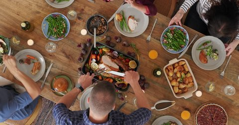 above view of family preparing table enjoying delicious vibrant thanksgiving meal together tasty homemade lunch time lapse camera rotate top view