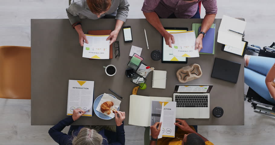 Top view of multi ethnic business team brainstorming innovative ideas for startup company developing market strategy time lapse close up | Shutterstock HD Video #1011129944