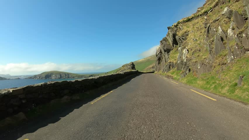Amazing roads in Ireland - driving along the Atlantic coast | Shutterstock HD Video #1011136124