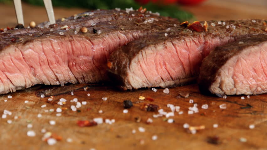 beef steak cooked medium well cut sliced knife