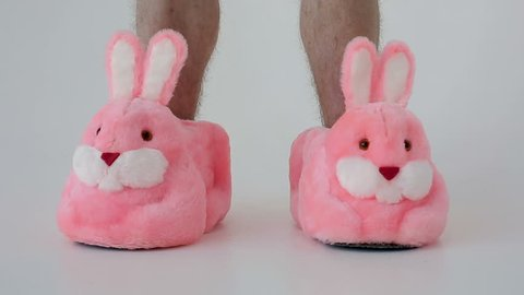 Slippers bunnies and men's feet
