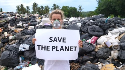 Woman Activist With Save The Planet Poster On Waste Dump. Recycle, Eco, Reuse Concept.