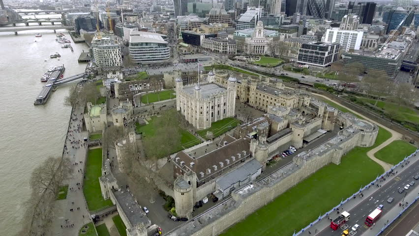 Aerial Bird Eye View Tower of London Her Majesty's Royal Palace and Fortress Historic Iconic Building in England, UK.  History around a Medieval Castle is a Famous Tourist Destination Landmark 4K - HD | Shutterstock HD Video #1011203624