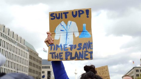 Suit up, time to save the planet, climate change, March for Science sign, Berlin