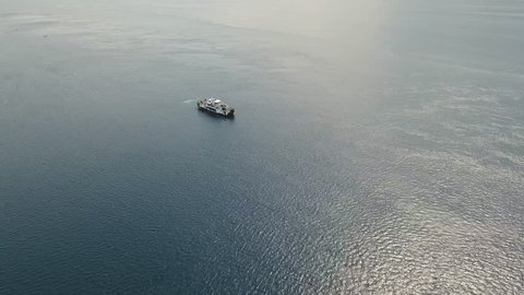 Aerial view passenger ferryboat in the blue sea, Gilimanuk, Bali,Indonesia. Ferry in the ocean. Port for departure from Bali to the island of Java. 4K video. Travel concept. Aerial footage.