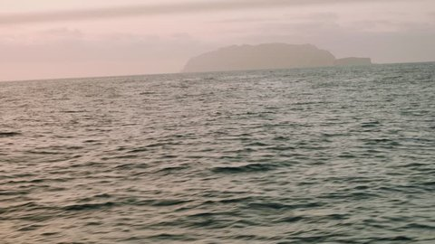 View of Deserta Grande in early morning from board of sailing yacht