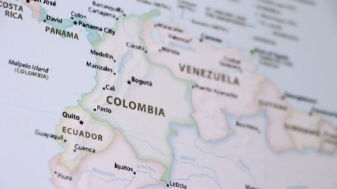 Colombia on a political map of the world. Video defocuses showing and hiding the map.