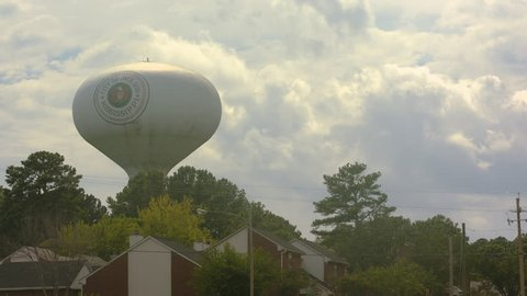 Time lapse shot of water tower in Jackson Mississippi, and of clouds rolling behind it in the sky