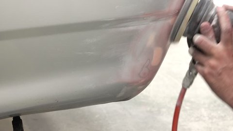 4K Putty  Garage Car body work car auto car repair car paint after the accident during the spraying automotive.