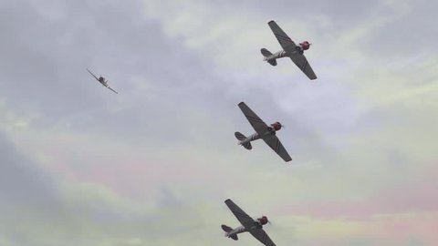 Squadron of World War II P51 military fighter bomber airplanes flying in slow motion