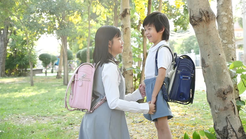 Cute Asian children going to the school outdoors slow motion   Shutterstock HD Video #1011314864