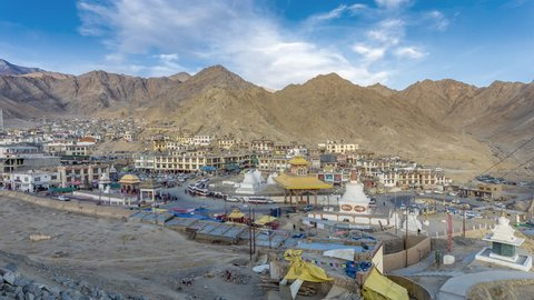 Traffic in bus stand, Leh city is located in the Indian Himalayas at an altitude of 3500 meters, Leh Cityscape viewed Kyigu Drak Gonpa in sunset time.