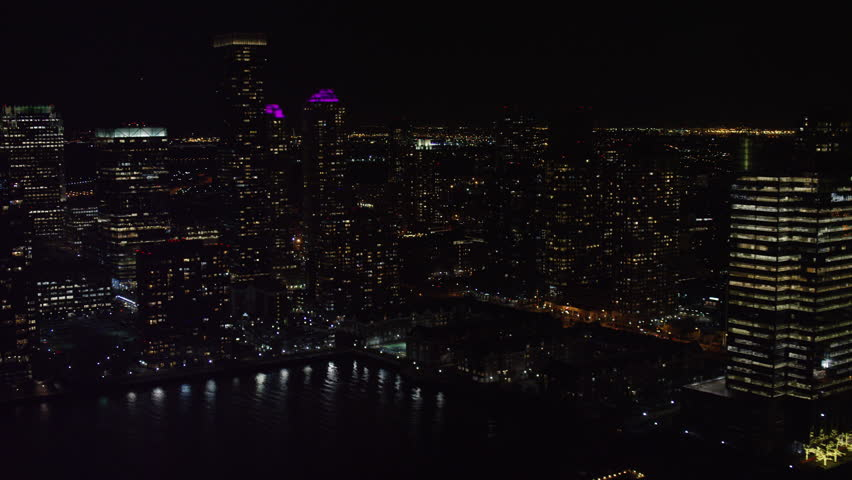 Aerial view of large city at night. Flying over skyscrapers in New York. Shot with a RED camera