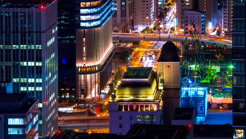 View of Osaka City at Night Time. View of The City From on High. on the Road Going Car With Headlights Included. | Shutterstock HD Video #1011341624